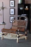 Lifestyle image of the Black & Natural Beautiful Rattan Lounge Chair