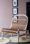 Angled lifestyle of the White & Natural Beautiful Rattan Lounge Chair