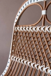 Close-up image of the detail on back of the White & Natural Beautiful Rattan Lounge Chair