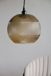 Image of the Pacific Glass Pendant Light hanging over a chair