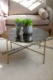 Lifestyle image of the Round Coffee Table With Bronze Oxidised Mirrored Top