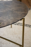 Close-up image of the top on the Round Coffee Table With Bronze Oxidised Mirrored Top