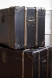 Close-up image of the Set Of 2 Traditional Black With Wooden Frame Storage Trunks