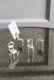 Lifestyle image of the Set Of 4 Silver Chair Place Card Holders