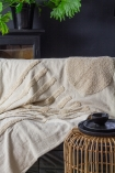 Lifestyle image of the Ivory Cream Soft Cotton Tufted Stripes & Dot Throw on a sofa