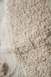 Close-up image of the texture on the Ivory Cream Soft Cotton Tufted Stripes & Dot Throw