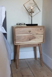Angled lifestyle image of the Solid Acacia Wood Bedside Table