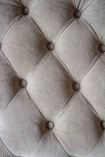 Close-up image of the button detailing on the back of the Stone Grey Suede Buttoned 2 Seater Sofa