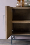 Close-up image of the shelves inside the Timber Strips Sideboard with the door open