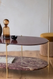 Close-up lifestyle image of the Wine Red Oval Marble & Brass Coffee Table