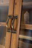 Close-up image of the handles on the Wooden Antique-Style Library Cabinet