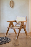 Left angled lifestyle image of the Woven Cane Mango Wood Armchair