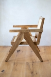 Side on image of the Woven Cane Mango Wood Armchair