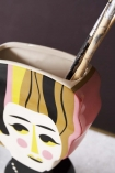 Close-up detail image from above of the Mrs Hoffman 60s Inspired Vase with paintbrushes inside on marble table and dark wall background