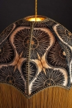 detail image of Anna Hayman Designs DecoFabulous Gold & Black Bibana Pendant Shade turned on with dark wall background
