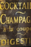 Close-up detail image of words on Antique Effect Bieres, Vins, Cocktails & Champagne Typography Mirror gold and black