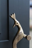 detail image of head on Set Of 2 Elegant Brass Peacock Door Handles on grey door background