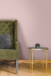 Lifestyle image of the Betsy Fan Ditsy Pink Wallpaper by Pearl Lowe with gold side table, green armchair and wooden flooring