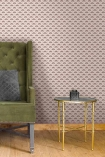 Lifestyle image of the Betsy Fan Ditsy Tobacco Wallpaper by Pearl Lowe with gold side table, green armchair and wooden flooring