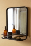 Lifestyle image of the Black Square Bathroom Mirror With Shelf hung on the wall