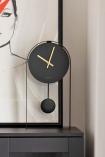 image of the Modern Black & Brass Pendulum Clock in the home of Sally Faye