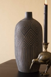 Lifestyle image of the Black African Ceramic Bottle Vase