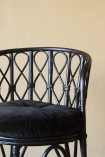 detail image of Black Bamboo Chair With Velvet Seat Pad with cloisters painted wall background