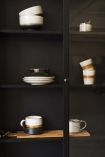 detail image of inside of Black Pine Display Cabinet filled with tableware
