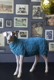 lifestyle image of Pikes At Rockett St George - Blue Party Sheep with glasses on and picture frame wallpaper and green disco ball