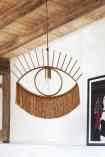 Lifestyle image of the Golden Eye Pendant Light With Fringing