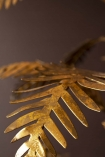 Close-up image of a leaf branch on the Tropical Palm Leaf Chandelier