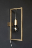 Lifestyle of Brass Effect Hanging Lamp In Frame fixed to dark grey wall bulb off