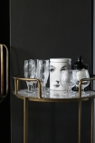 Gatsby Marble & Brass Effect Drinks Trolley with glasses and face pot on dark background close up detail image