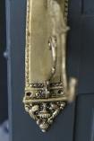 detail image of bottom of Brass Parrot Design Door Handle  Wall Hook on grey door background