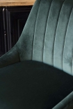 detail image of seat on Tall Casino Velvet Bar Stool - Rich Green with bar in background