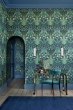 Lifestyle image of the Bluebell Wallpaper in Sage, Mint & Lilac On Charcoal by Cole & Son