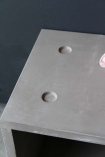 detail image of surface on Lyon Beton Concrete Dice StoolTable - Available In 2 Sizes with dark wall background