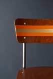 detail image of painting Contemporary Hand-Painted School Chair - Charlotte's Locks Orange & Gold on dark wall background