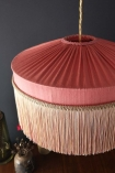 Close-up image of the top of the Bespoke Coral Hibiscus Silk Tiffany Lamp Shade with straight fringe