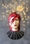Front-on image of the Ziggy Hanging Christmas Tree Decoration on a sparkly background