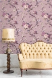 Lifestyle image of the Dawn Chorus Smokey Heather Wallpaper by Pearl Lowe with pale yellow sofa and floor lamp