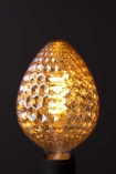 Close-up detail image of the E27 4W LED Amber Light Bulb lit up on dark wall background