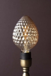 lifestyle Image of the E27 4W LED Amber Light Bulb not lit on dark wall background