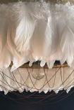 detail image of Fabulous Feather Chandelier Featuring Chains - Gloria - White with dark wall background