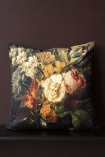 Lifestyle image of the Summer Flowers Velvet Cushion on bench