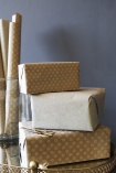 lifestyle image of Set Of 15 Sheets Of Hand Made Glitter Gift Wrap - White wrapped presents in pile
