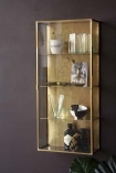 Lifestyle image of the Brass & Glass Wall-Mounted Display Cabinet angled on dark wall background