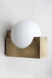 Lifestyle image of the Atlas Globe Wall Light on a wall switched off