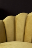 Close-up detail image of the petal detail on the Ochre Gold Velvet Petal Occasional Chair with dark wall background