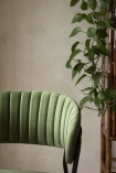 Close-up of the curved detail on the back of the Curved Back Velvet Dining Chair In Moss Green